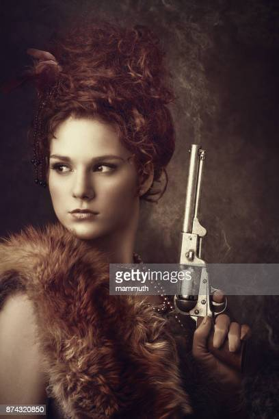 wild west diva with smoking revolver - diva human role stock photos and pictures
