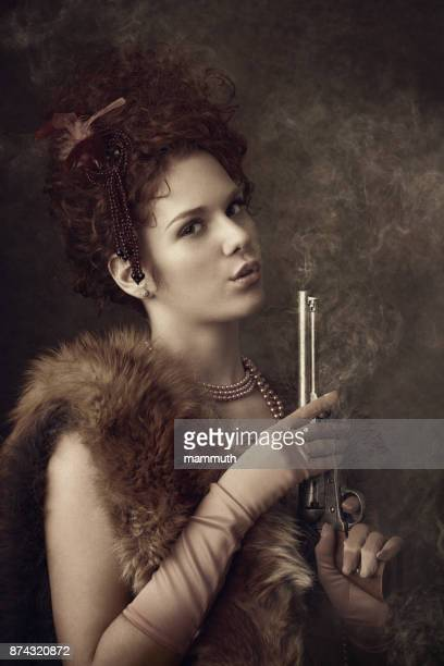 Wild west diva with smoking revolver