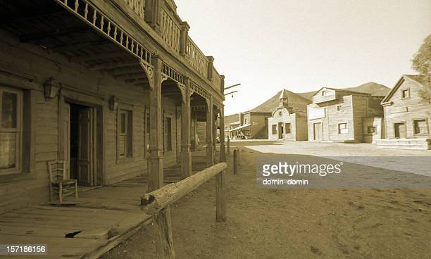 wild west, old wooden buildings, houses, sepia toned - town stock pictures, royalty-free photos & images