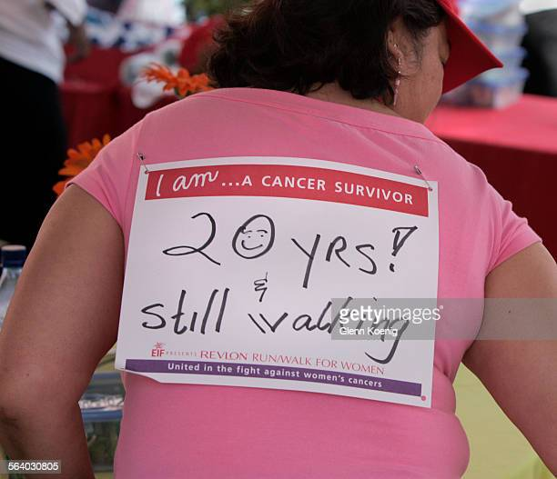 Wilda Castelo of Monterey Park sports a sign that tells of her survival for 20 years She had just completed the 5k walk at the Entertainment Industry...