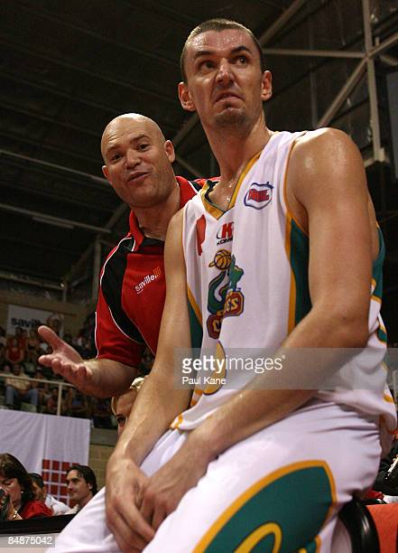 Wildcats fan offers Russell Hinder of the Crocodiles some advice during the NBL quarter final match between the Perth Wildcats and the Townsville...