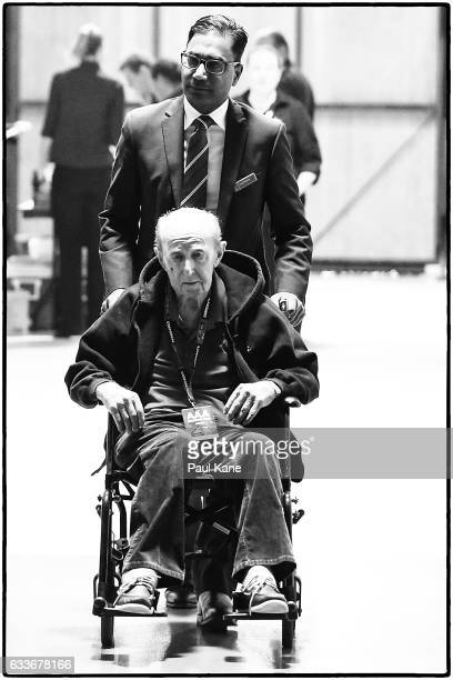 Image was altered with digital filters Wildcats owner Jack Bendat is pushed in a wheel chair by CEO Nick Marvin from the changerooms to his seating...