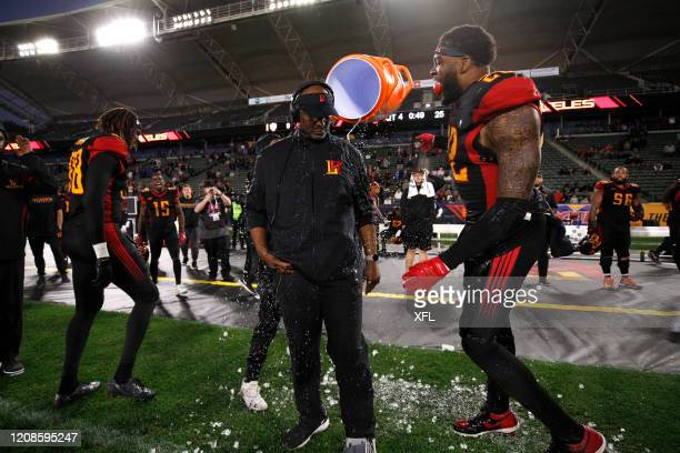 Wildcats players dump water on head coach Winston Moss of the LA Wildcats in celebration during the XFL game against the DC Defenders at Dignity...