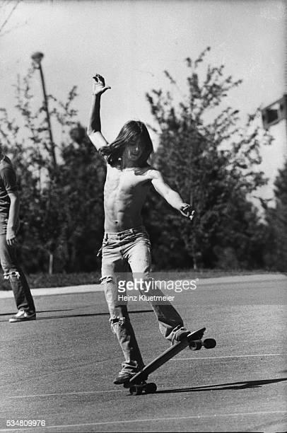 Wilde Lake High School freshman rides a skateboard in a parking lot, Columbia, Maryland, 1977.
