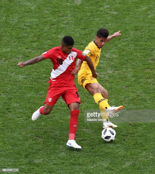 Wilder Cartagena of Peru battles for possession with Daniel Arzani of Australia during the 2018 FIFA World Cup Russia group C match between Australia...