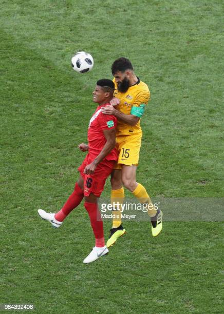 Wilder Cartagena of Peru competes for a header with Mile Jedinak of Australia during the 2018 FIFA World Cup Russia group C match between Australia...
