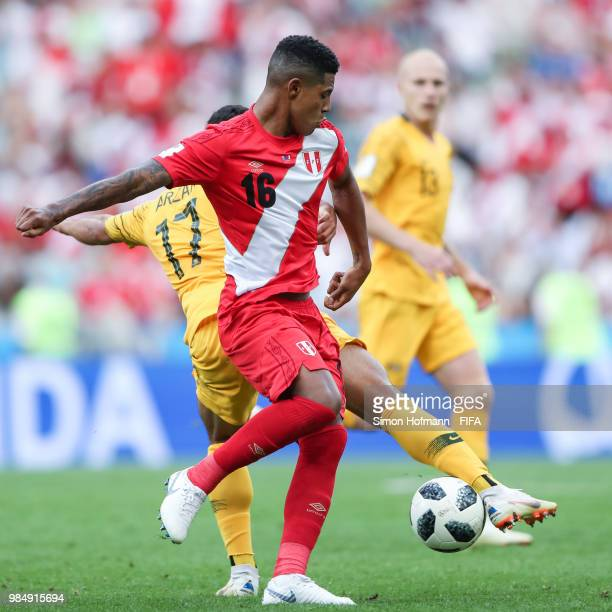 Wilder Cartagena of Peru is challenged by Daniel Arzano of Australia during the 2018 FIFA World Cup Russia group C match between Australia and Peru...