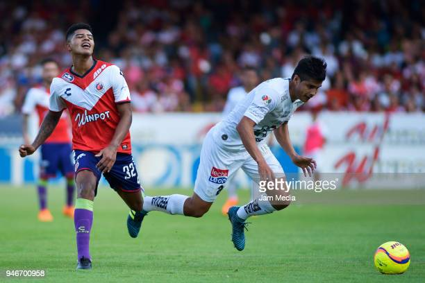 Wilder Cartagena of Veracruz and Miguel Herrera of Leon fight for the ball during the 15th round match between Veracruz and Leon as part of the...