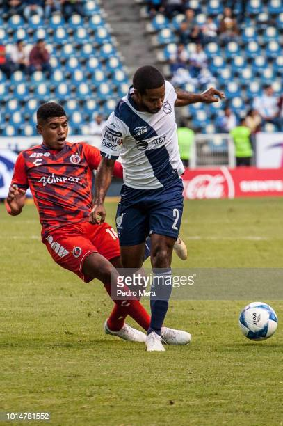 Wilder Cartagena of Veracruz slides to take the ball from Alexis Angulo of Puebla during a match between Puebla and Veracruz as part of Torneo...