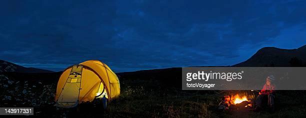 Wilderness camp fire child toasing marshmallows Scotland