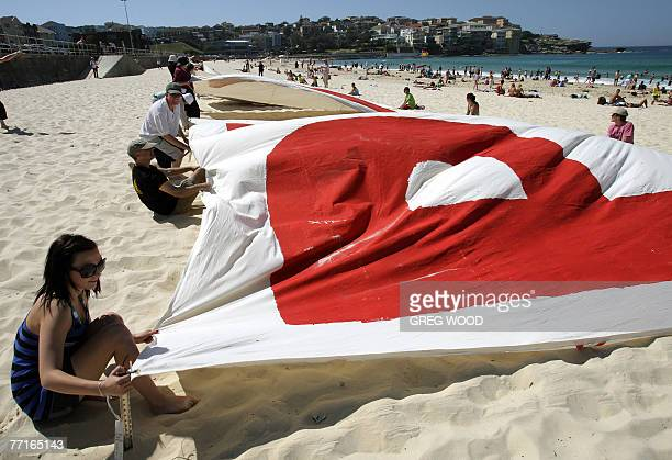 Wilderness Society members lay out giant letters on Sydney's Bondi Beach 03 October 2007 asking the federal government to stop the timber company...