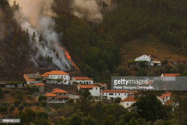 A wildfire approaches Mega Fundeira village after a wildfire took dozens of lives on June 20 2017 near Picha in Leiria district Portugal On Saturday...
