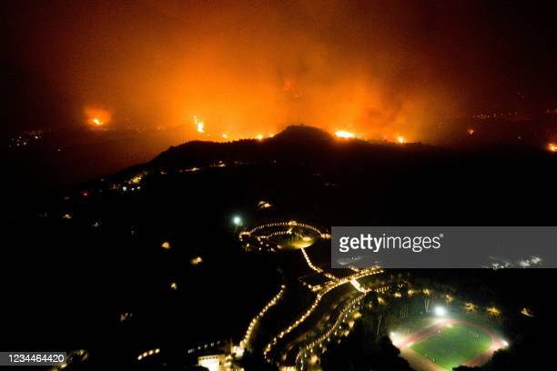 Wildfire approaches the Olympic Academy in ancient Olympia in western Greece on August 4, 2021. - Greek firefighters have been battling several...