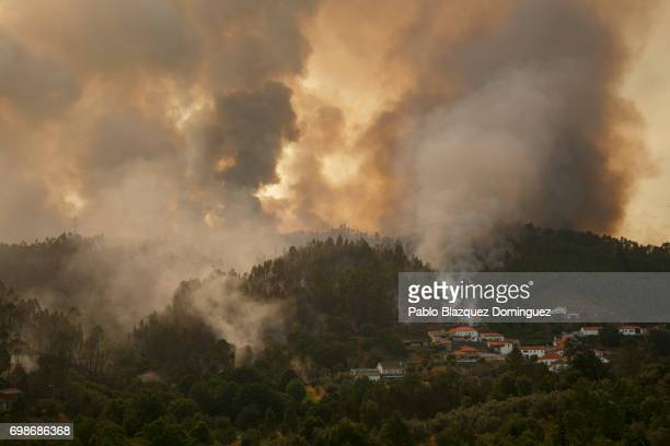 A wildfire approaches to Mega Fundeira village after a wildfire took dozens of lives on June 20 2017 near Picha in Leiria district Portugal On...