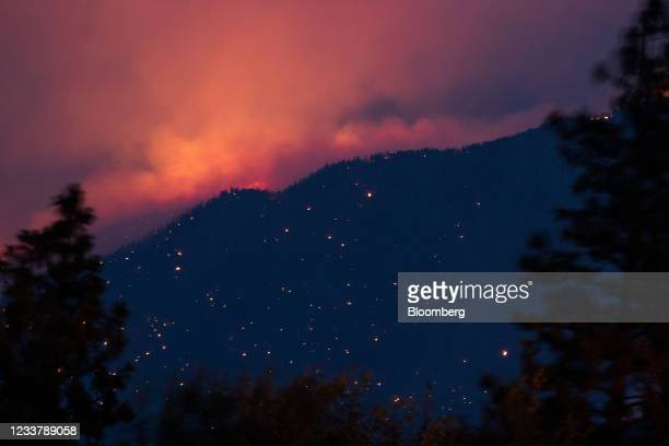 Wildfire burns above the Fraser River Valley near Lytton, British Columbia, Canada, on Friday, July 2, 2021. A protracted heat wave continues to fuel...
