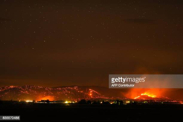 A wildfire burns in sagebrush and grass on a sidehill in Warm Springs Oregon on August 18 2017 The fire is burning over 60000 acres and is displacing...