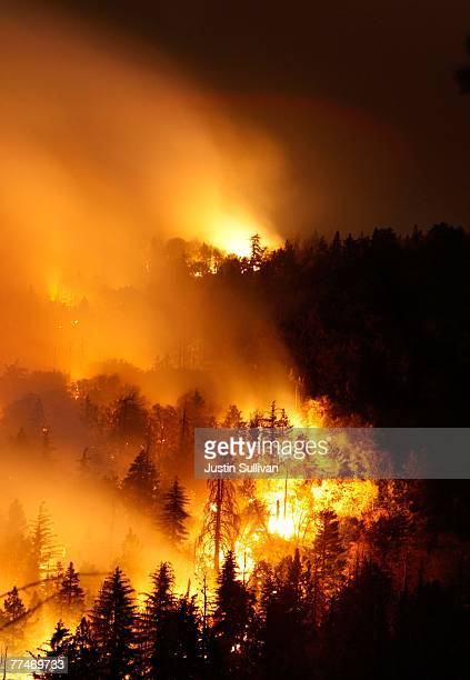 A wildfire burns out of control as it moves towards Lake Arrowhead October 23 2007 in Running Springs California Nearly 500000 people have been...