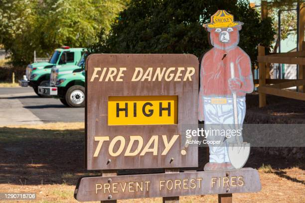 a wildfire danger sign in sprinville, near porterville, california, usa. - springville california stock pictures, royalty-free photos & images