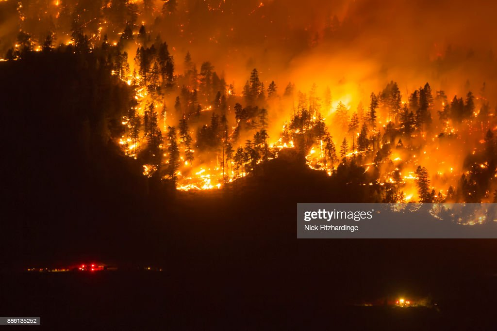 A wildfire frontline with emergency services nearby, Okanagan Valley, British Columbia, Canada : Stock Photo