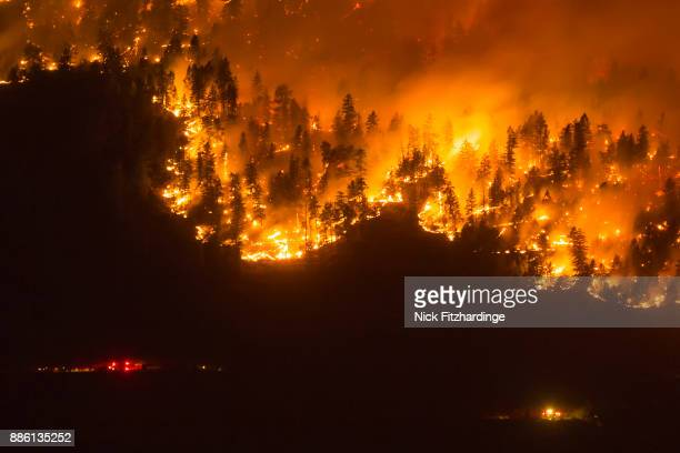 a wildfire frontline with emergency services nearby, okanagan valley, british columbia, canada - forest fire stock pictures, royalty-free photos & images