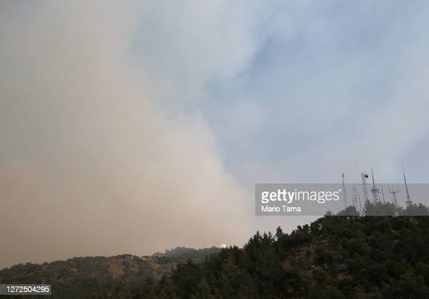 Wildfire smoke rises near communication towers on Mount Wilson as the Bobcat Fire burns in the Angeles National Forest on September 14, 2020 near...