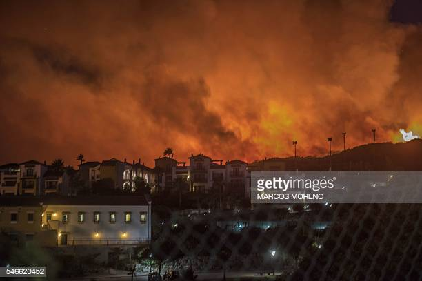 A wildfire threatens Hotel Aldiana and houses in the seaside resort of Alcaidesa near Sotogrande province of Cadiz Spain on July 12 2016 About 420...
