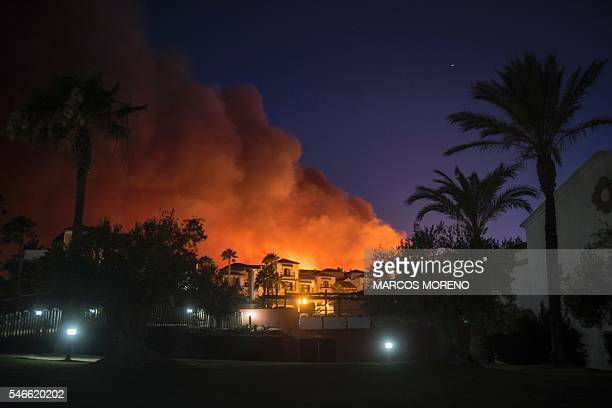 A wildfire threatens Hotel Aldiana in the seaside resort of Alcaidesa near Sotogrande province of Cadiz Spain on July 12 2016 About 420 guests...