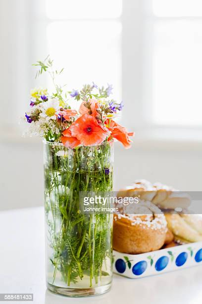Wildflowers in vase,  cookies on background