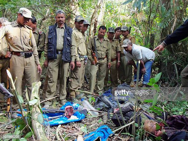 Wildlife officials surround the bodies of two rhino poachers who where killed during an encounter in Kaziranga National Park of Assam on December 14...