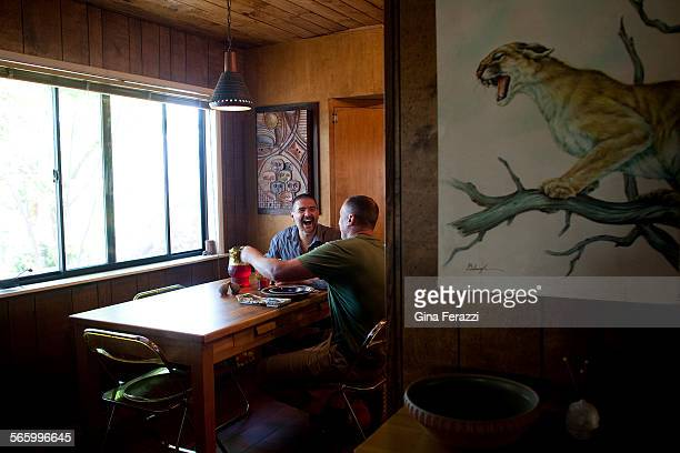A wildlife painting hangs in the hallway near the kitchen as Glen Steigelman and Steve Halterman hang out at the kitchen table
