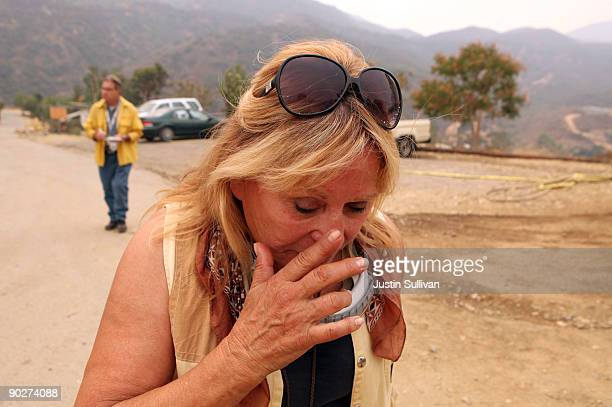 Wildlife Waystation founder Martine Colette wipes a tear after she watched a group of chimpanzees being evacuated from the 160 acre animal sanctuary...