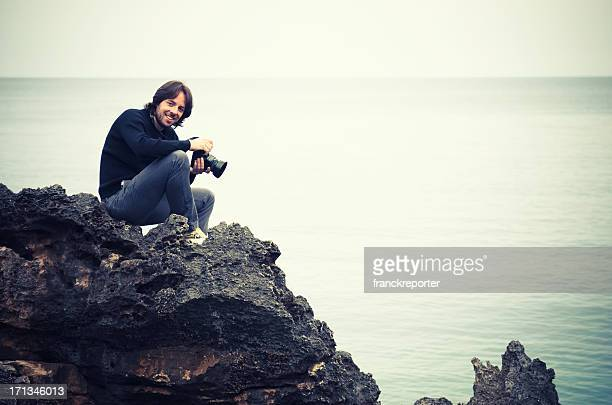wildness photographer on the rock
