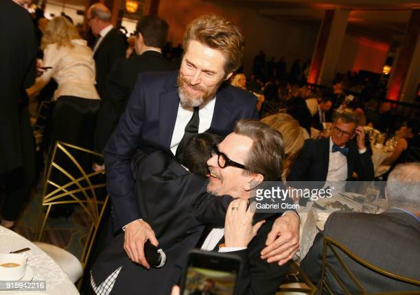 Wilem Defoe Christopher Rivera and Gary Oldman attend AARP's 17th Annual Movies For Grownups Awards at the Beverly Wilshire Four Seasons Hotel on...