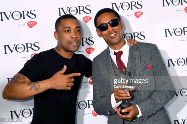 Wiley poses with Richard Cowie Senior after winning The Ivors Inspiration Award at The Ivors 2019 at Grosvenor House on May 23, 2019 in London,...