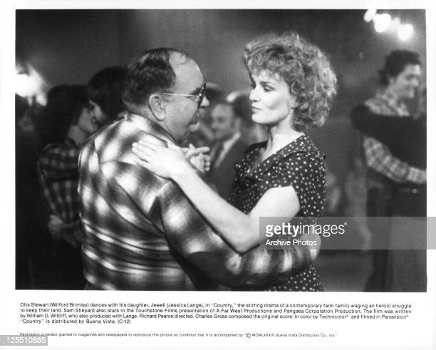 Wilford Brimley And Jessica Lange dance in a scene from the film 'Country' 1984