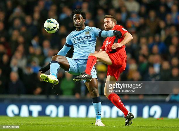 Wilfred Bony of Manchester City and Matthew Upson of Leicester City compete for the ball during the Barclays Premier League match between Manchester...