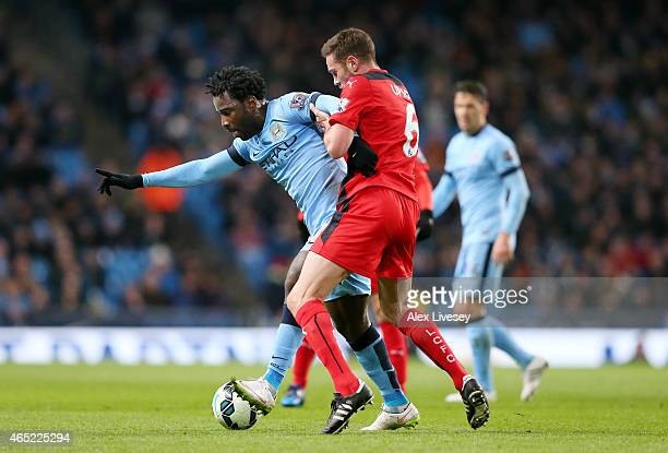 Wilfred Bony of Manchester City c24 is challenged by Matthew Upson of Leicester City during the Barclays Premier League match between Manchester City...