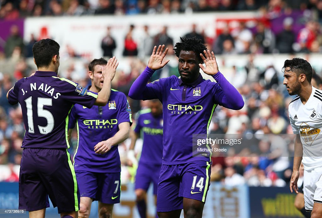 Wilfred Bony of Manchester City celebrates with teammate Jesus Navas of Manchester City after scoring his team's fourth goal during the Barclays Premier League match between Swansea and Manchester City at the Liberty Stadium on May 17, 2015 in Swansea, Wales.
