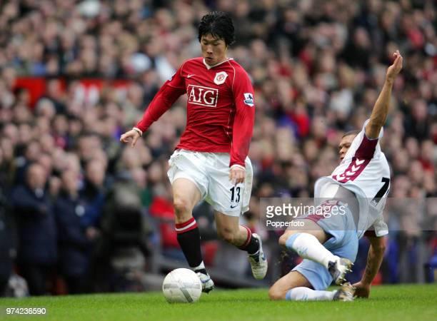 Wilfred Bouma of Aston Villa tackles Ji Sung Park of Manchester United during the FA Cup 3rd Round match between Manchester United and Aston Villa at...