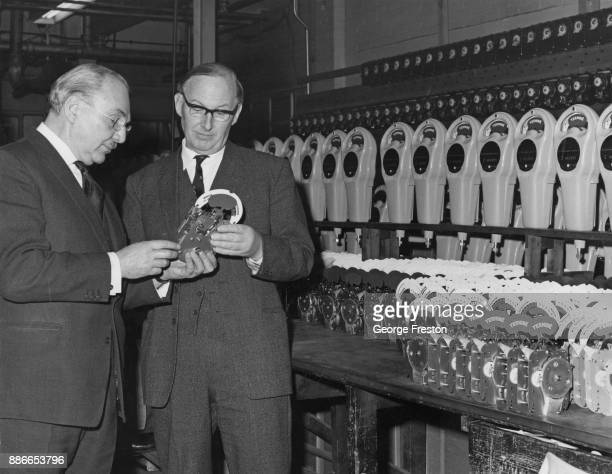 Wilfred Brown Baron Brown the Minister of State at the Board of Trade is shown some of the parking meters ordered for Orly Airport in France by E...