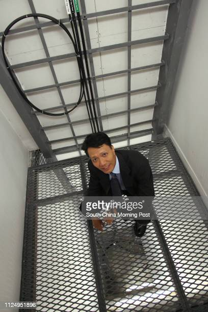 Wilfred Kwan president and chief technology officer of Asia Netcom pictured the optical fibres which come from the main lines undersea at their HQ IN...