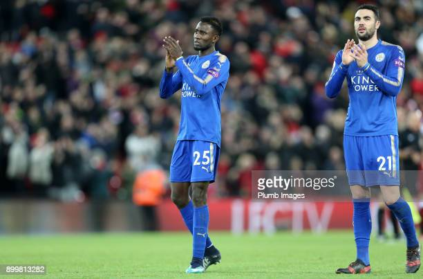 Wilfred Ndidi and Vicente Iborra of Leicester City applaud the travelling fans after the Premier League match between Liverpool and Leicester City at...