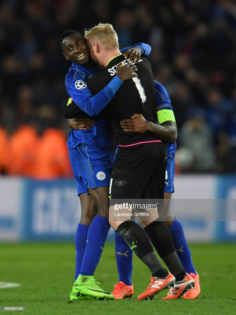 Wilfred Ndidi, Kasper Schmeichel and Wes Morgan of Leicester City celebrate as the final whistle blows during the UEFA Champions League Round of 16, second leg match between Leicester City and Sevilla FC at The King Power Stadium on March 14, 2017 in Leicester, United Kingdom.