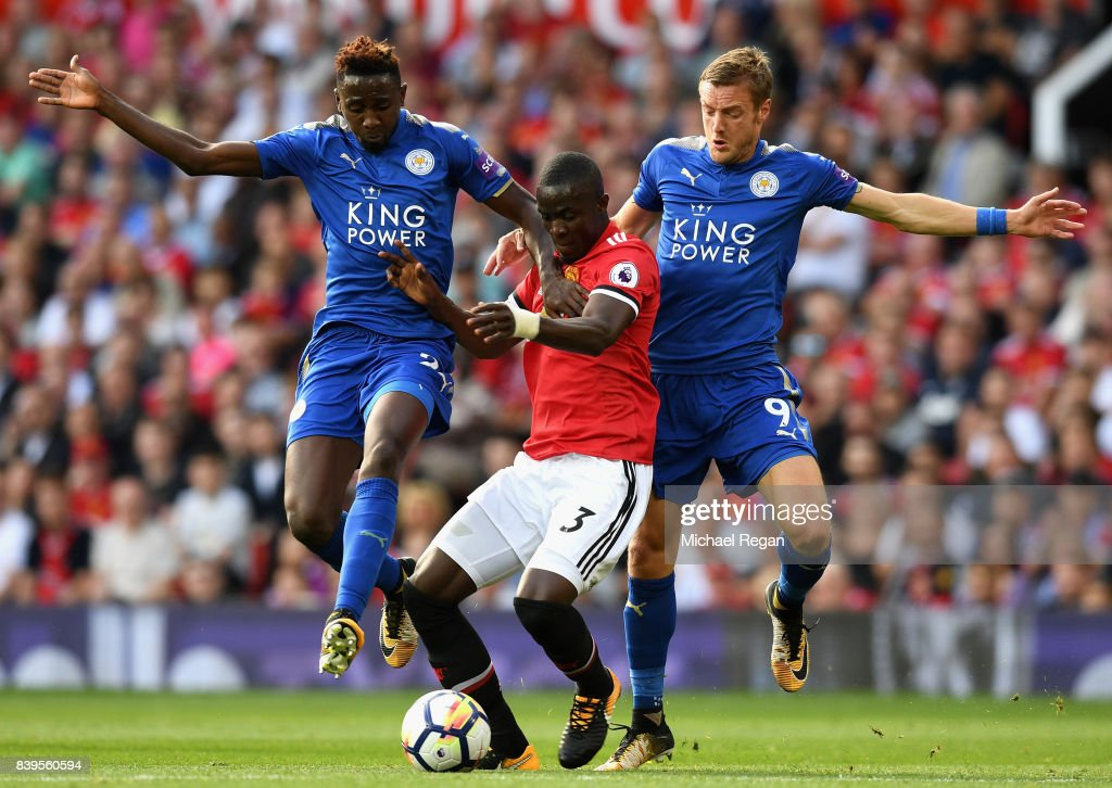 Wilfred Ndidi of Leicester City and Jamie Vardy of Leicester City battle for possession with Eric Bailly of Manchester United during the Premier League match between Manchester United and Leicester City at Old Trafford on August 26, 2017 in Manchester, England.