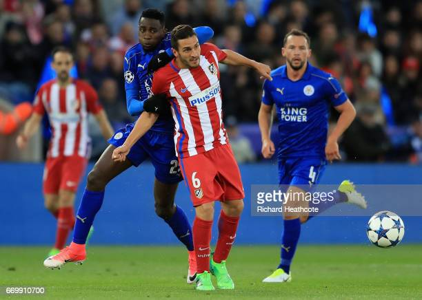 Wilfred Ndidi of Leicester City and Koke of Atletico Madrid battle for possession during the UEFA Champions League Quarter Final second leg match...