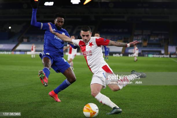 Wilfred Ndidi of Leicester City and Nicolae Stanciu of Slavia Prague during the UEFA Europa League Round of 32 match between Leicester City and...