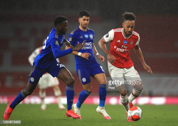 Wilfred Ndidi of Leicester City and Pierre-Emerick Aubameyang of Arsenal battle for the ball during the Premier League match between Arsenal FC and...