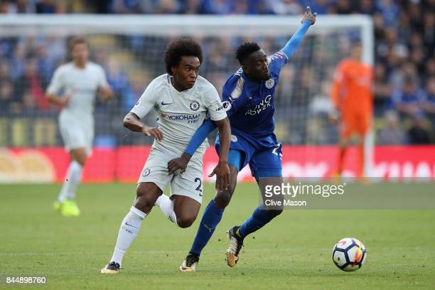 Wilfred Ndidi of Leicester City and Willian of Chelsea battle for possession during the Premier League match between Leicester City and Chelsea at...