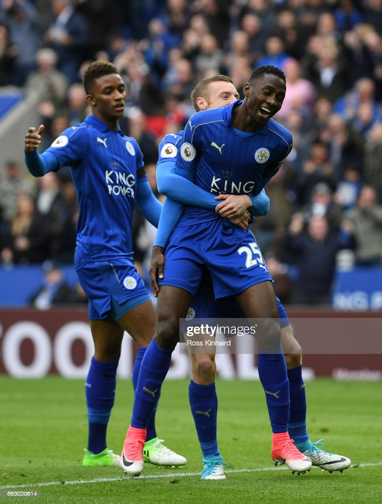 Wilfred Ndidi of Leicester City (R) celebrates scoring his sides first goal with Jamie Vardy of Leicester City (C/obscure) during the Premier League match between Leicester City and Stoke City at The King Power Stadium on April 1, 2017 in Leicester, England.