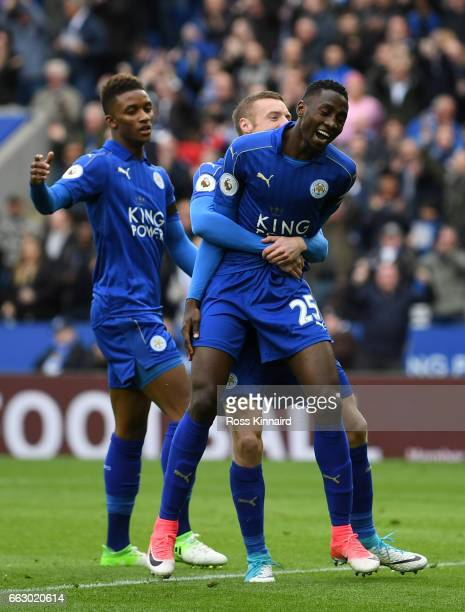 Wilfred Ndidi of Leicester City celebrates scoring his sides first goal with Jamie Vardy of Leicester City during the Premier League match between...